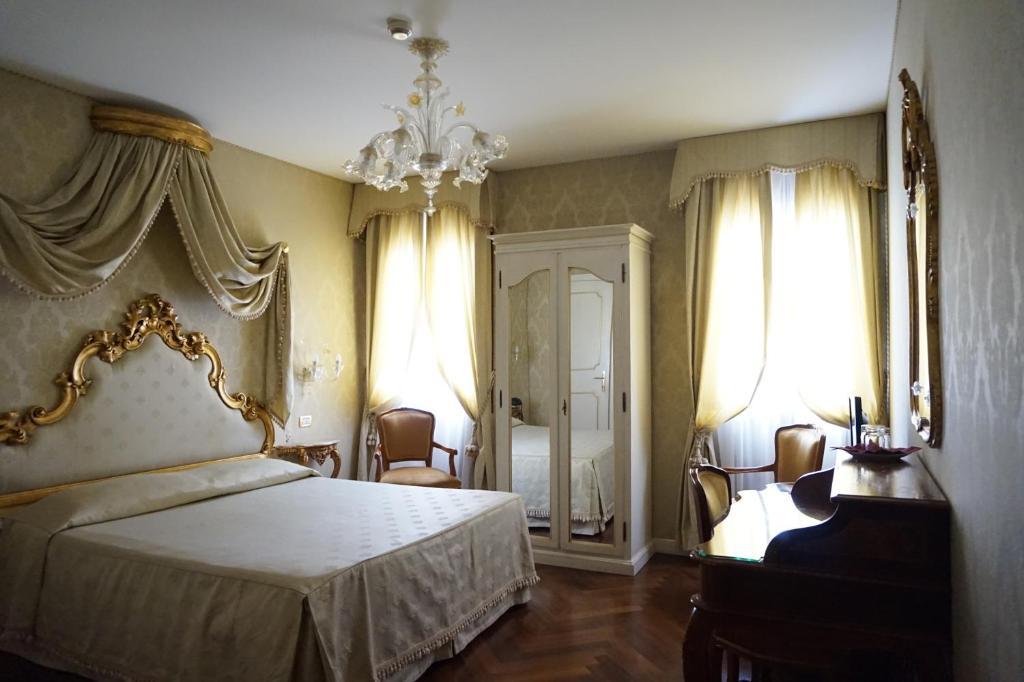 A bed or beds in a room at La Locanda Di Orsaria