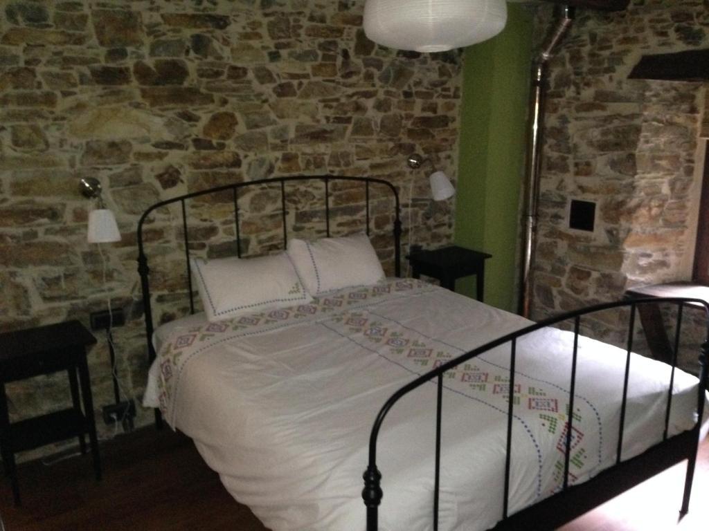 Cama o camas de una habitación en Casa Rural Doiras