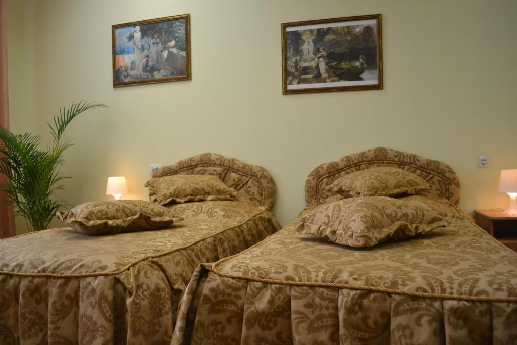 A bed or beds in a room at Mini-Hotel At Sukharevskaya