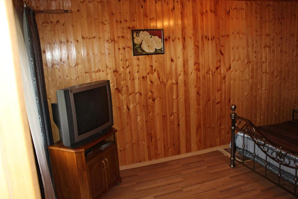 A television and/or entertainment center at Guest House at Spass