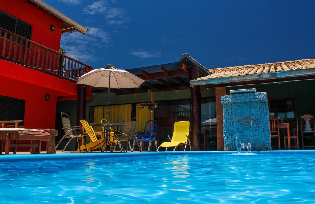 The swimming pool at or near Pousada Bonito Cama e Café