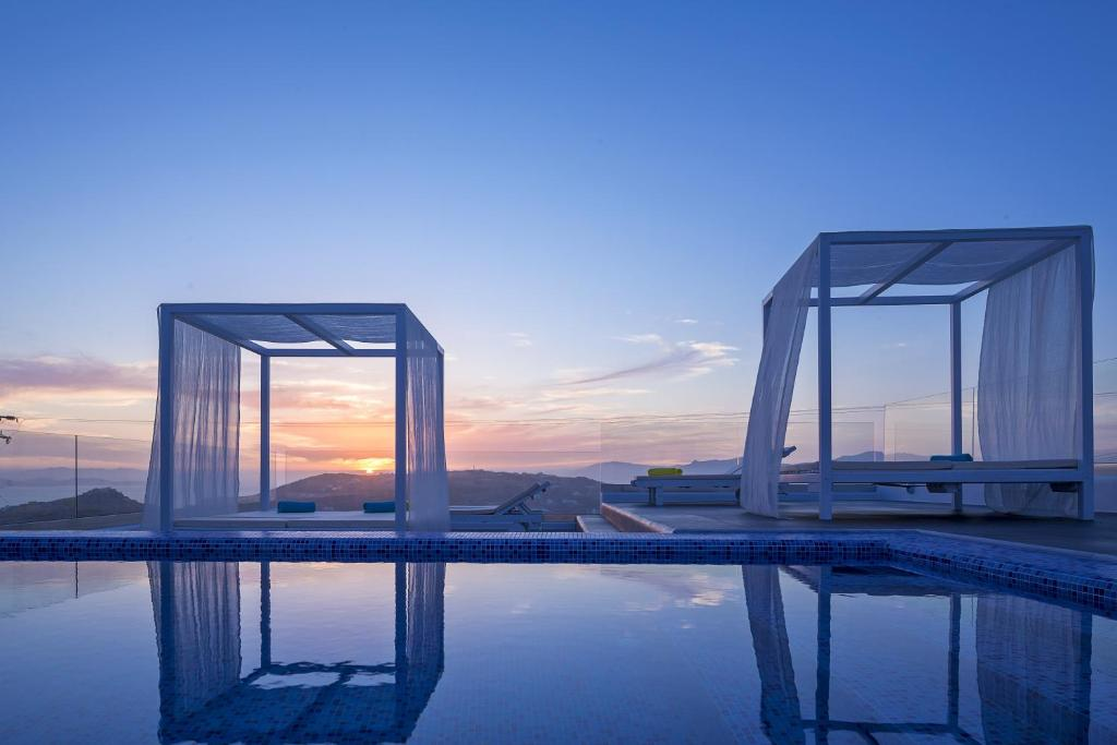 The swimming pool at or near Colours of Mykonos Luxury Residences & Suites