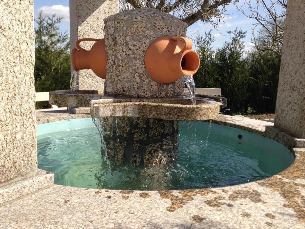 The swimming pool at or near Gites Des Sablons