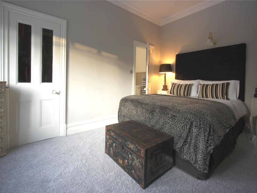 A bed or beds in a room at Oakthwaite