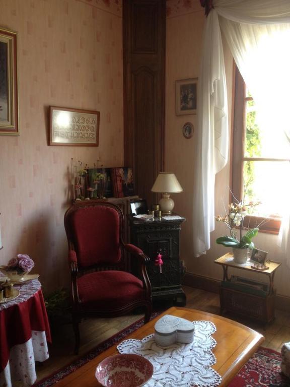 Coin salon dans l'établissement Chambres D'Hôtes Des 3 Rois