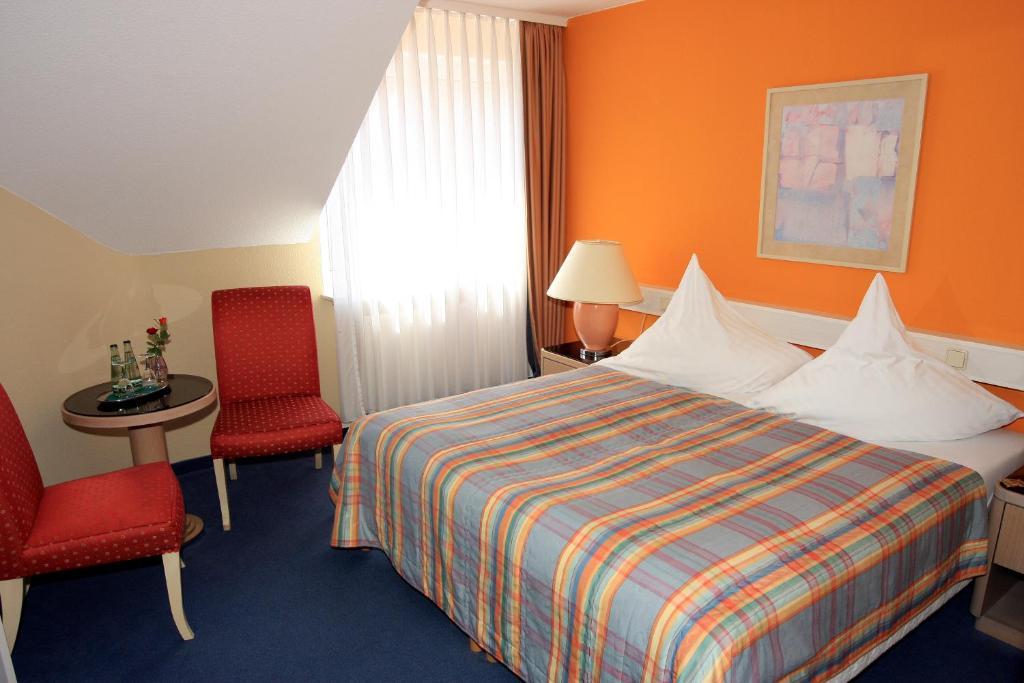 Ein Bett oder Betten in einem Zimmer der Unterkunft Ilmenauer Hof