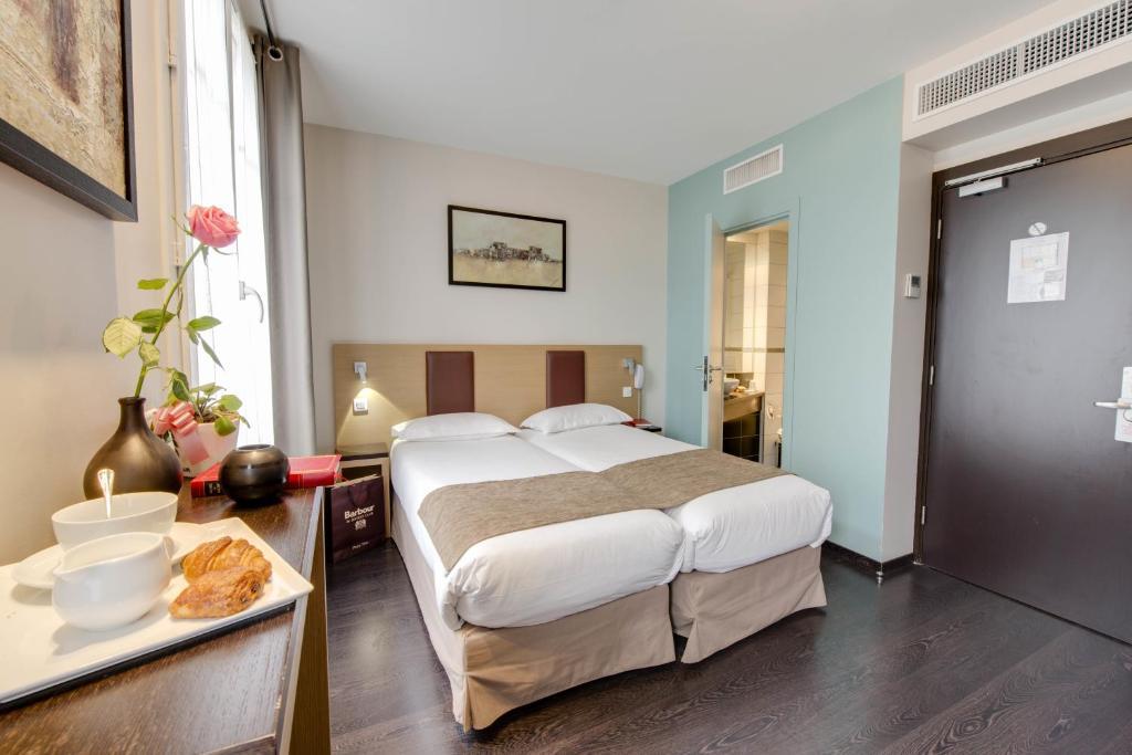Lova arba lovos apgyvendinimo įstaigoje Source Hôtel