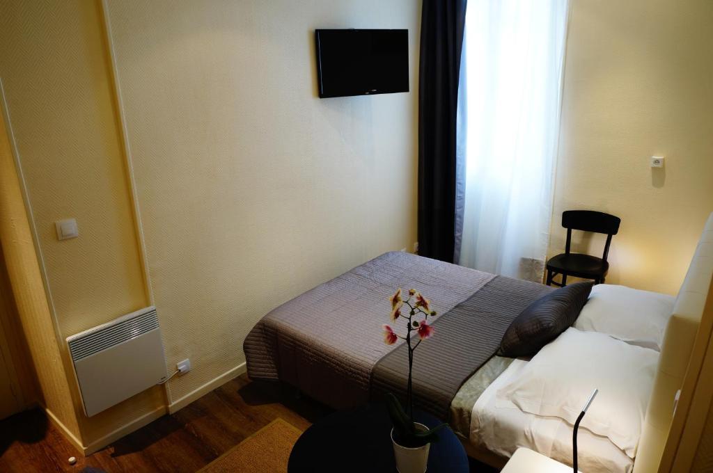 Säng eller sängar i ett rum på Hotel Zora