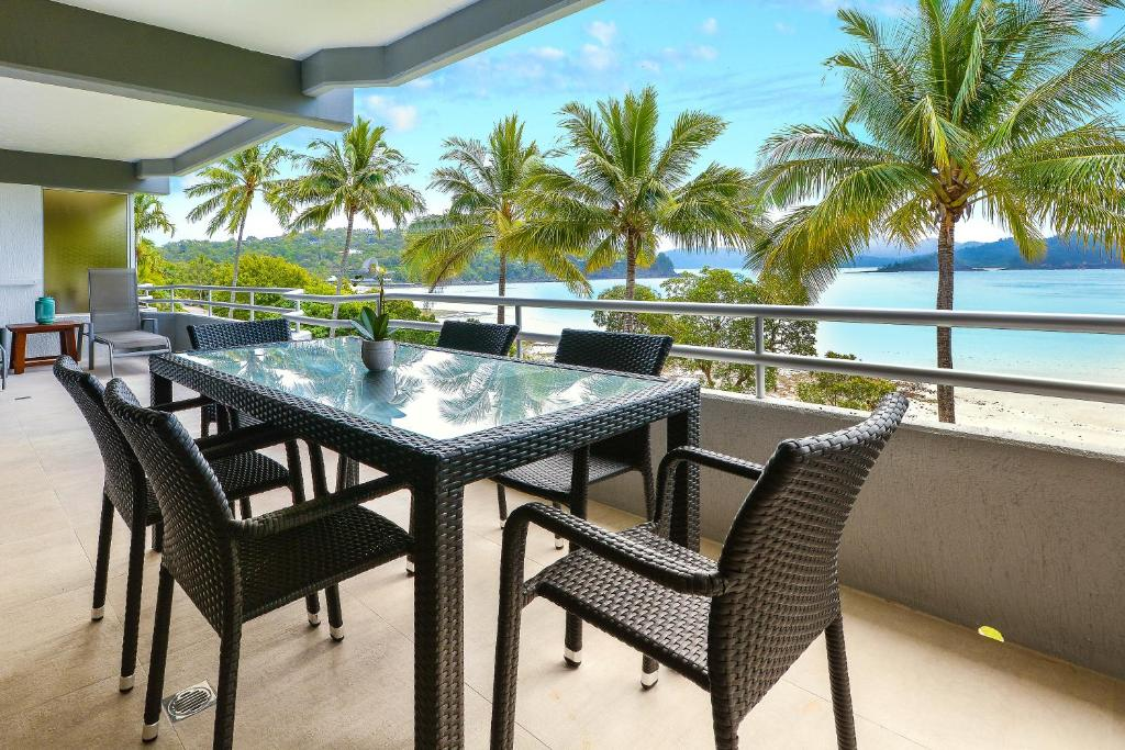 A balcony or terrace at Frangipani 104 - Hamilton Island