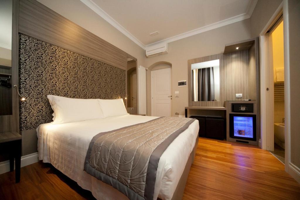 Een bed of bedden in een kamer bij B&B Residenza le Fonticine