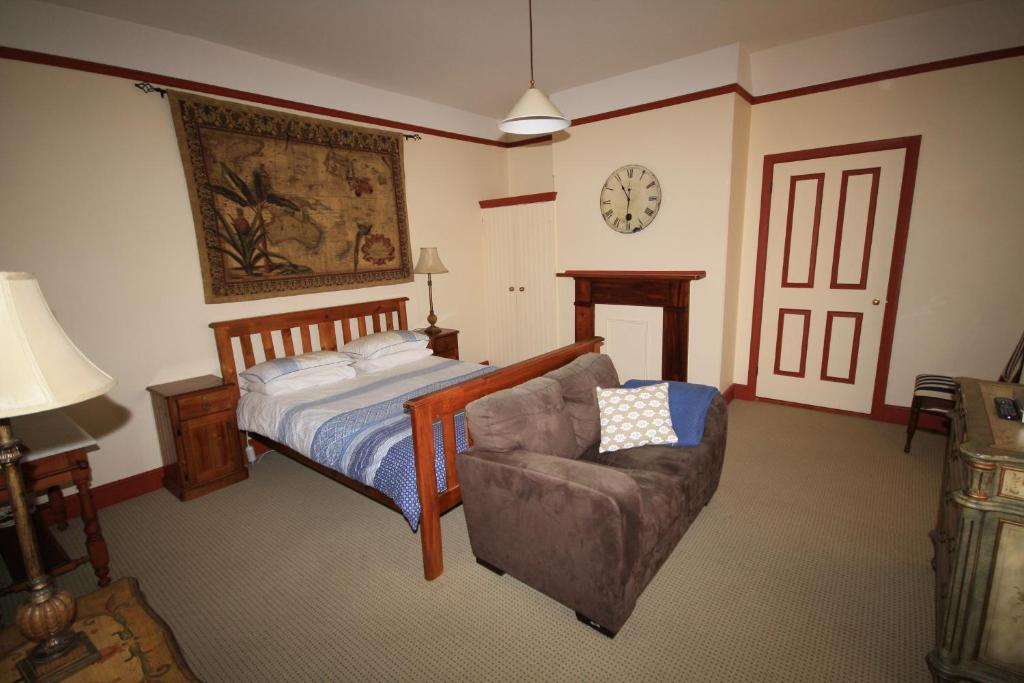 A bed or beds in a room at Grange Apartments