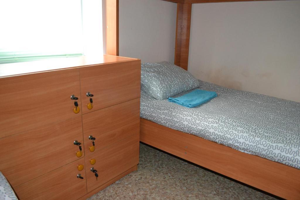 Кровать или кровати в номере Хостел Тулка