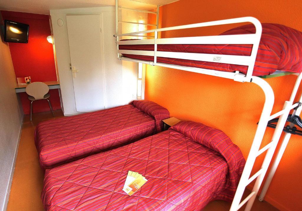 Un ou plusieurs lits superposés dans un hébergement de l'établissement Premiere Classe Grenoble Nord Moirans