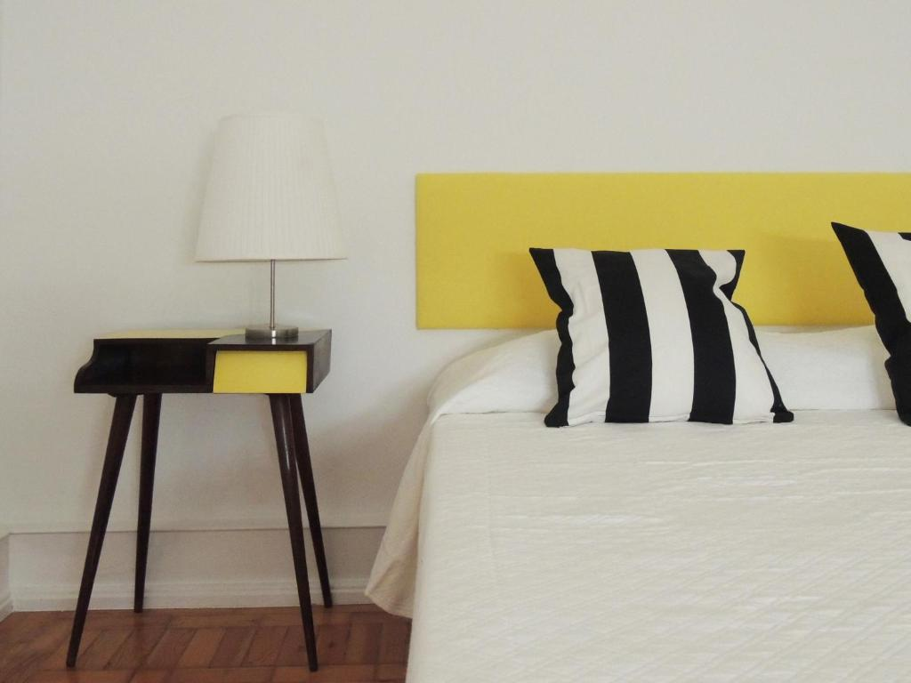 Uma cama ou camas num quarto em 71 Castilho Guest House