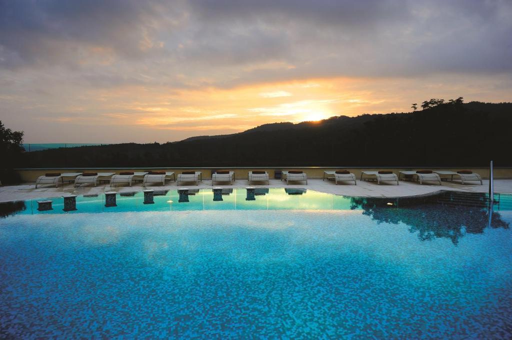 The swimming pool at or near Mercure Petriolo Siena Terme Spa Hotel