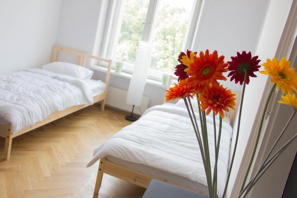 Posteľ alebo postele v izbe v ubytovaní Grand Central Hostel