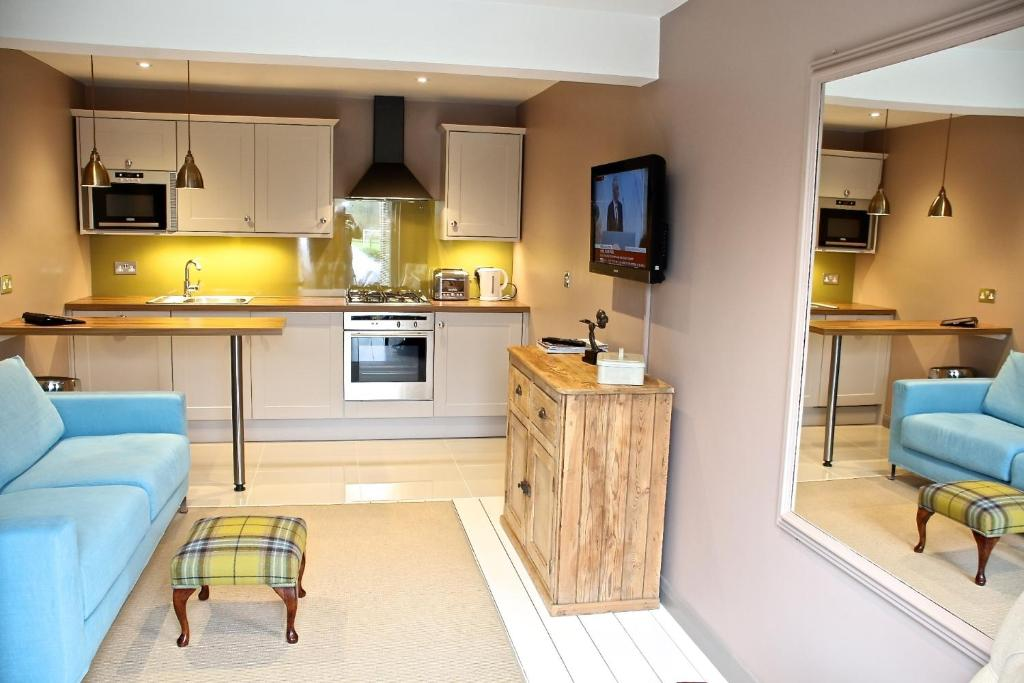 A kitchen or kitchenette at The Apartments @ Quidhampton Mill