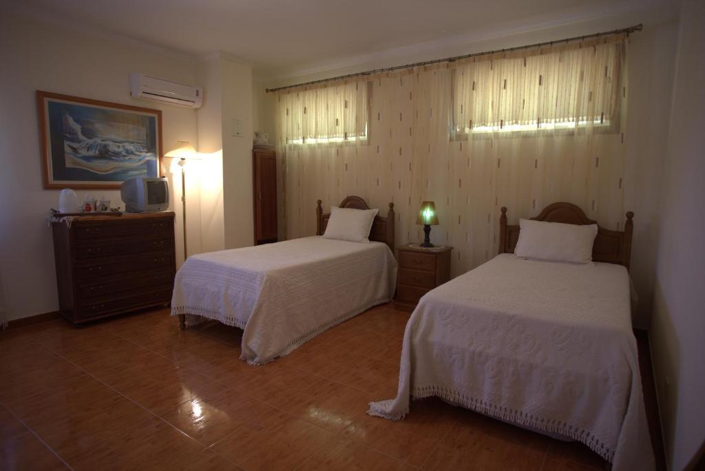 Uma cama ou camas num quarto em Casa Das Aguas Ferreas