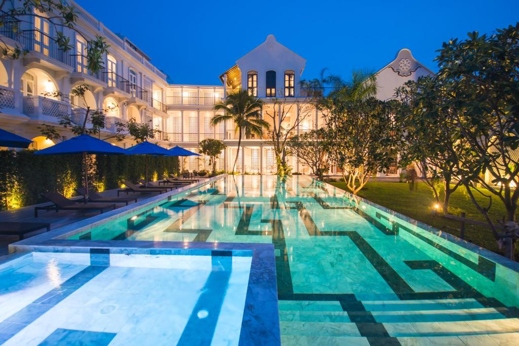 The swimming pool at or near Little Nyonya Hotel