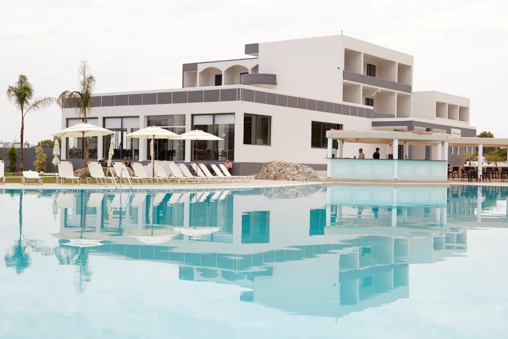 Het zwembad bij of vlak bij Evita Sun Resort