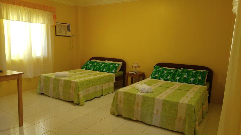 A bed or beds in a room at Villa Almedilla Pension House