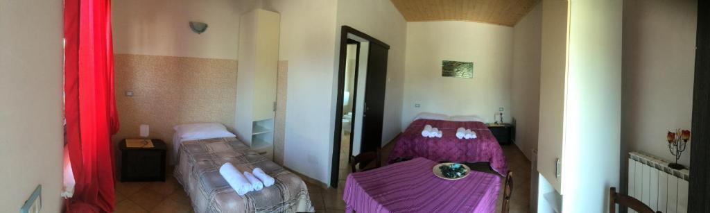 A bed or beds in a room at B&B La Foglietta