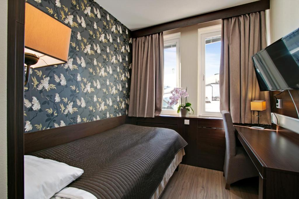 Ein Bett oder Betten in einem Zimmer der Unterkunft Brunnby Hotel