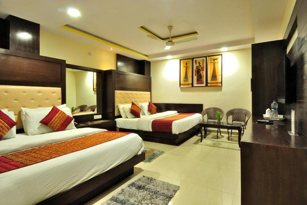 Säng eller sängar i ett rum på Hotel Shelton