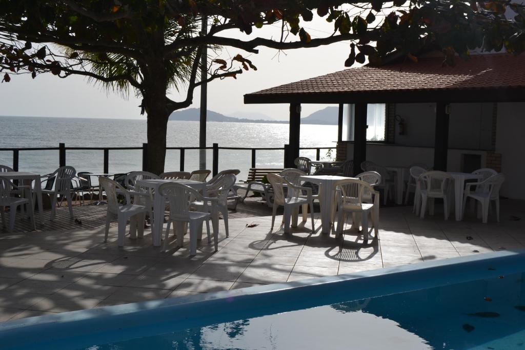 The swimming pool at or near Pousada dos Golfinhos