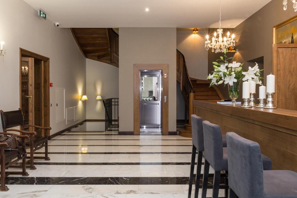 Vestibiulis arba registratūra apgyvendinimo įstaigoje Grottger Luxury Boutique Hotel City