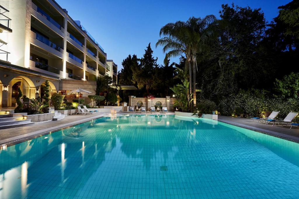 The swimming pool at or near Rodos Park Suites & Spa