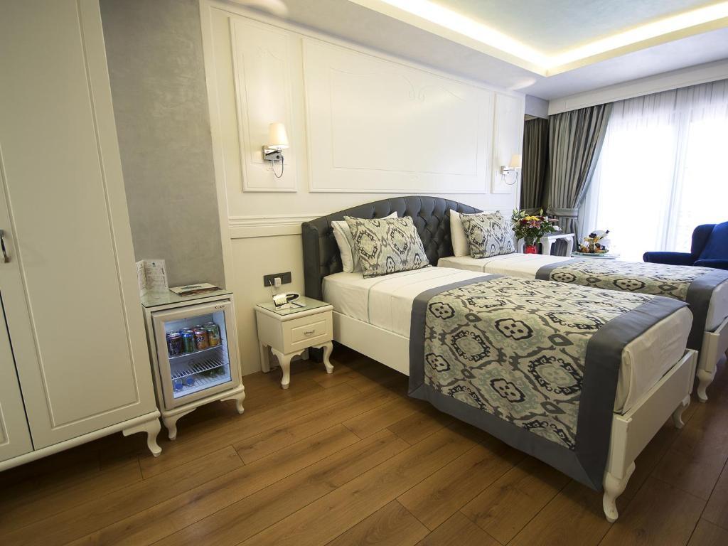 Кровать или кровати в номере Antusa Palace Hotel & Spa