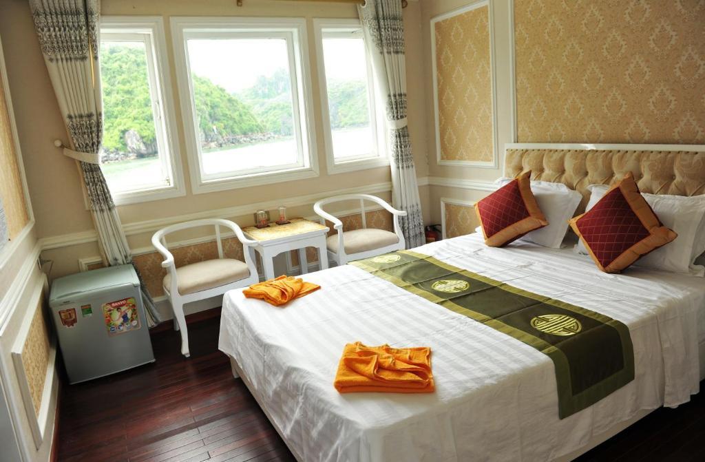 Un ou plusieurs lits dans un hébergement de l'établissement Love Planet Cruise
