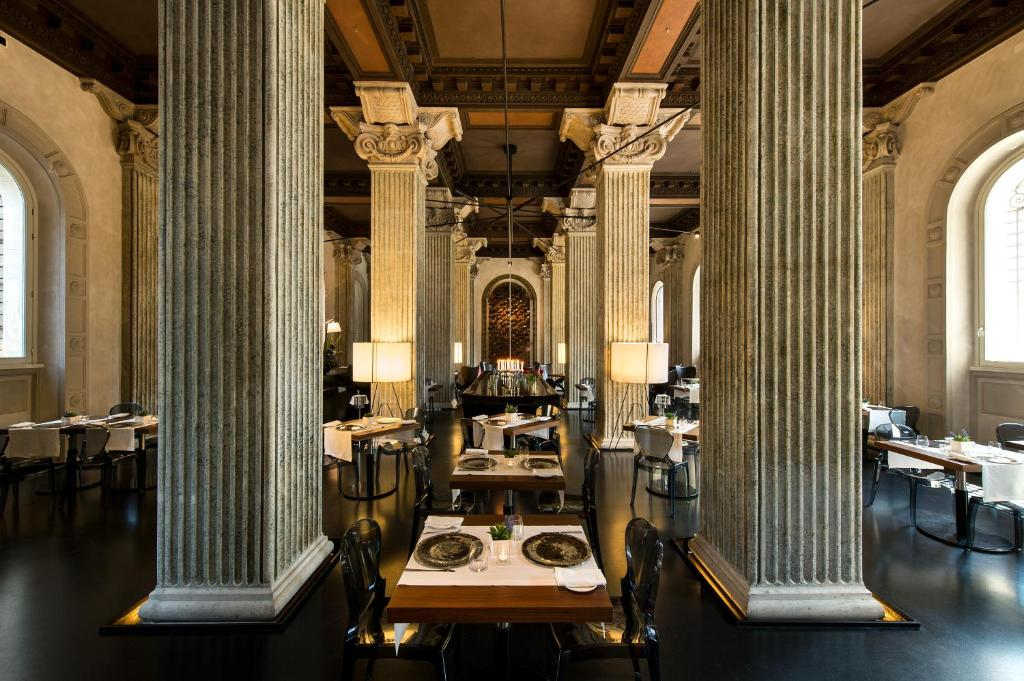 A restaurant or other place to eat at Palazzo Montemartini Rome, A Radisson Collection Hotel