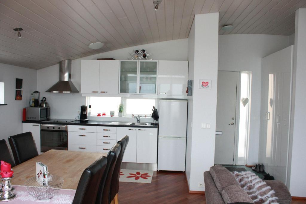 A kitchen or kitchenette at Vesturgata Apartment
