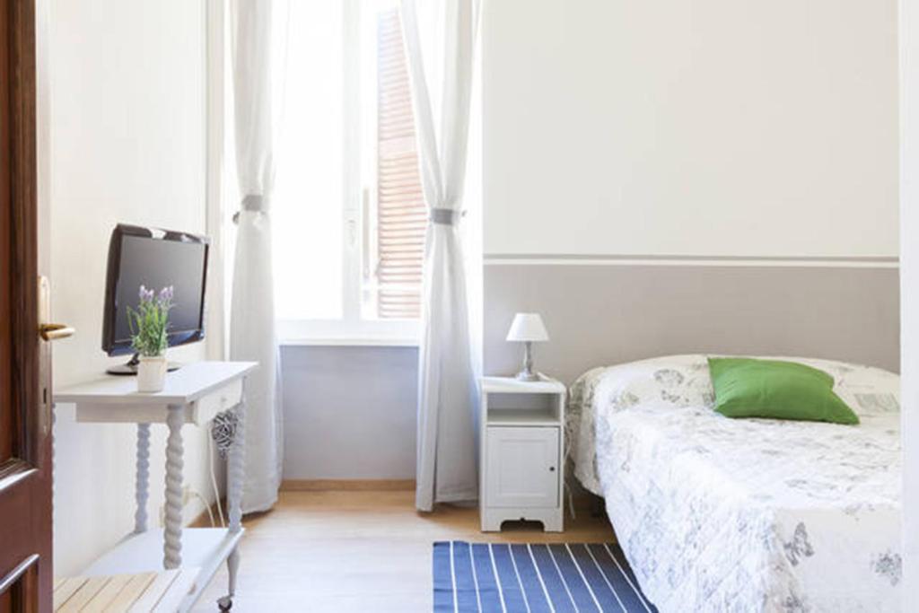 Posteľ alebo postele v izbe v ubytovaní Domus Merulana B&B