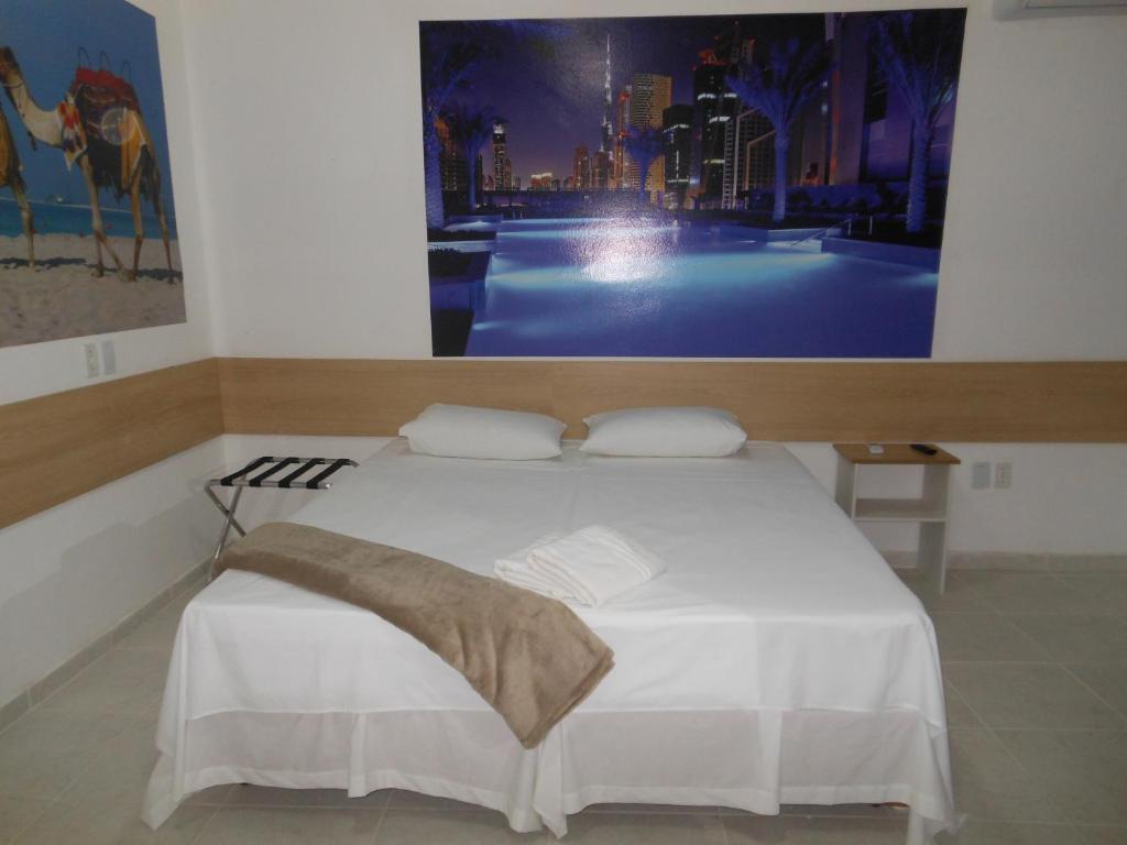 Cama ou camas em um quarto em Pousada Dubai