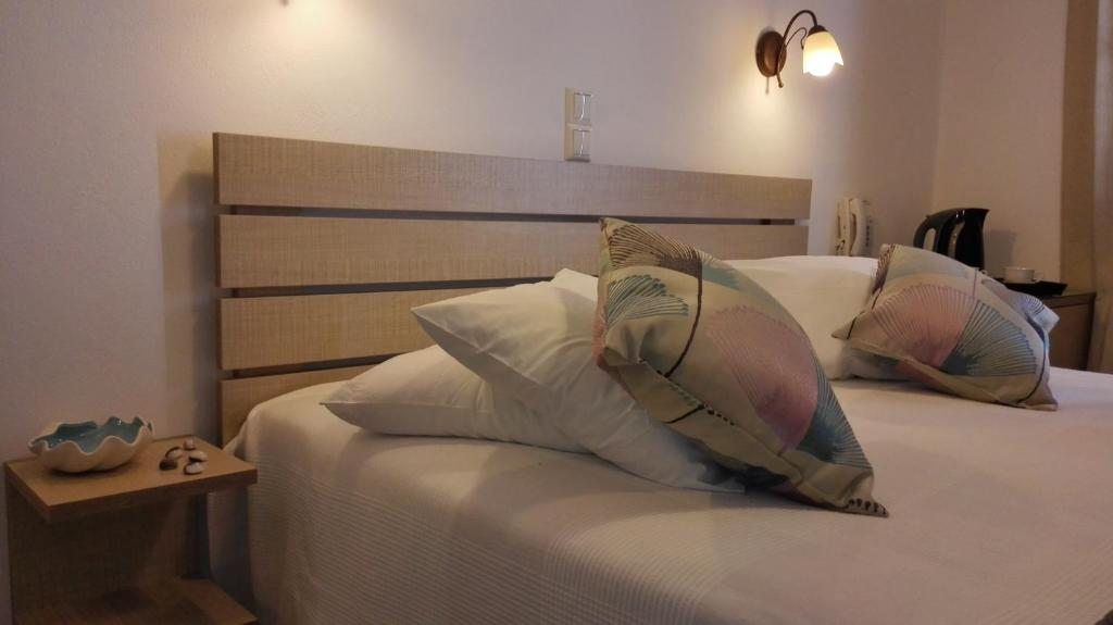 A bed or beds in a room at Christina Hotel
