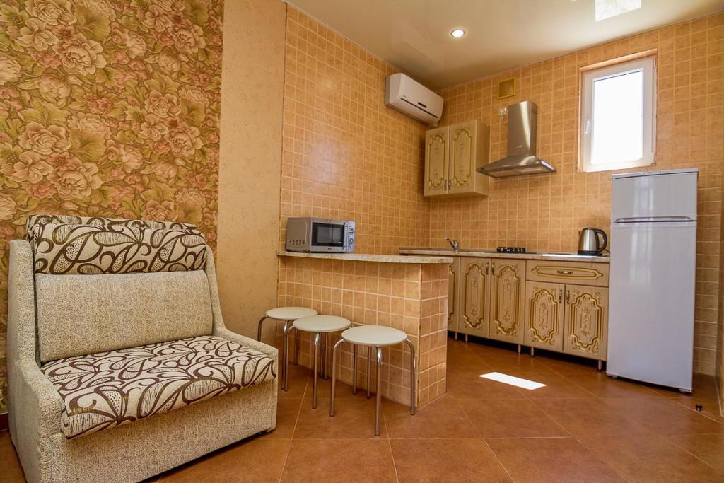 A kitchen or kitchenette at Guest House August