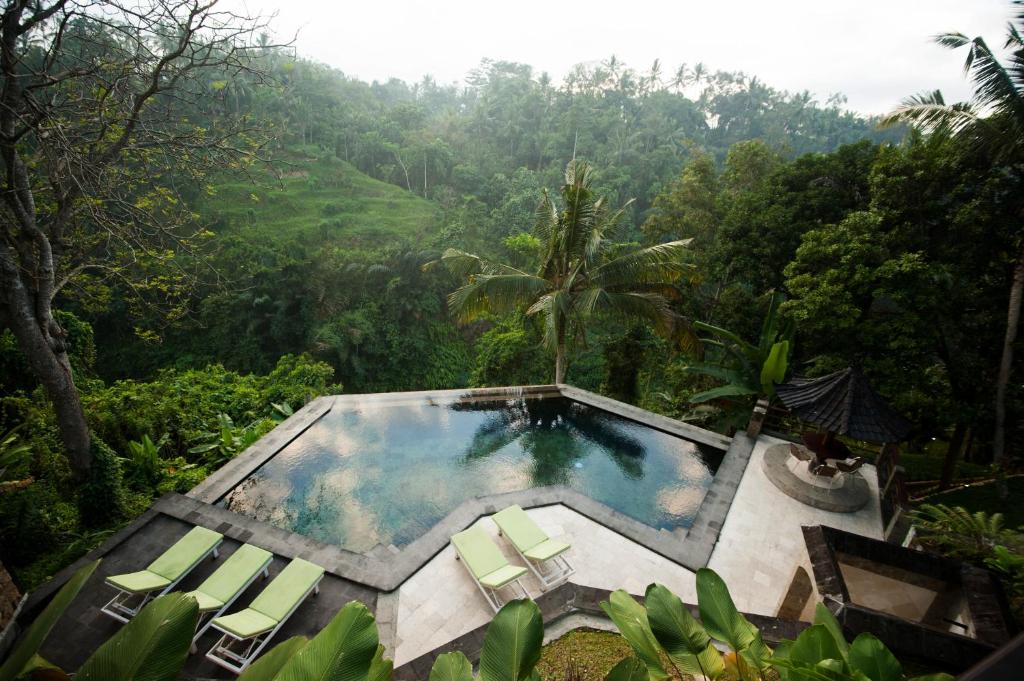 The swimming pool at or near Beji Ubud Resort