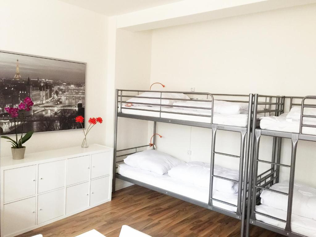 A bunk bed or bunk beds in a room at MAC City Hostel