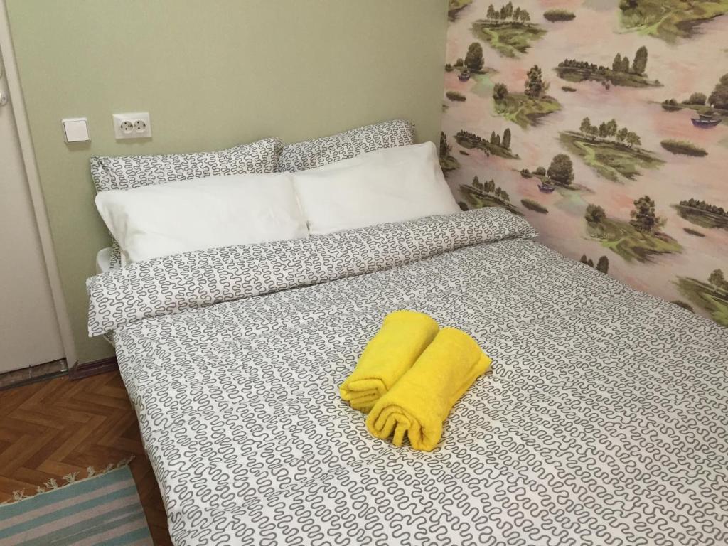 Кровать или кровати в номере Кукареку Мини Отель
