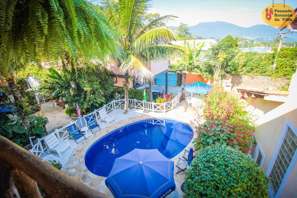 Вид на бассейн в VELINN Pousada Recanto da Villa или окрестностях