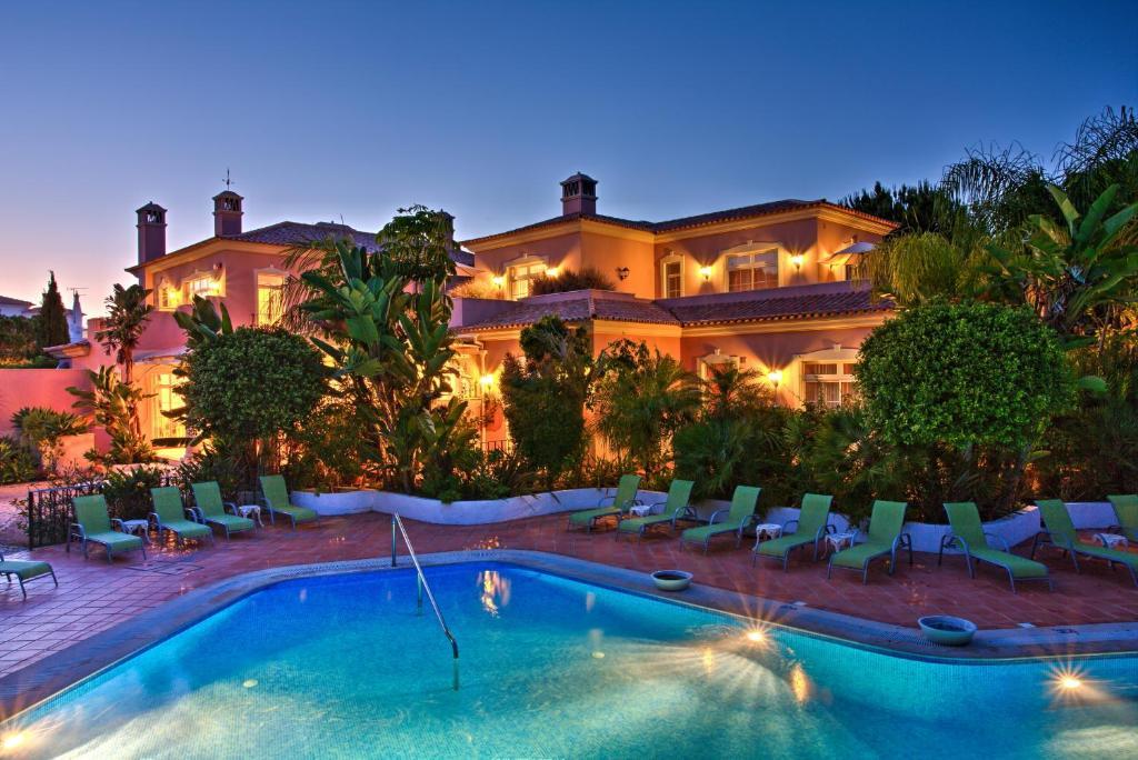The swimming pool at or near Quinta Jacintina - My Secret Garden Hotel