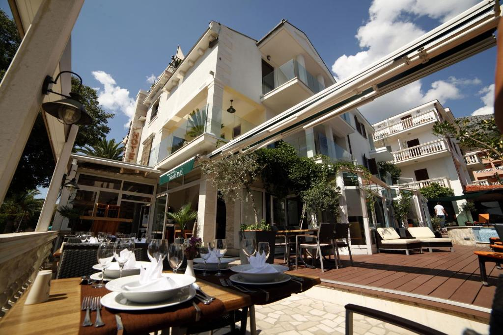 A restaurant or other place to eat at Boutique Hotel Marco Polo