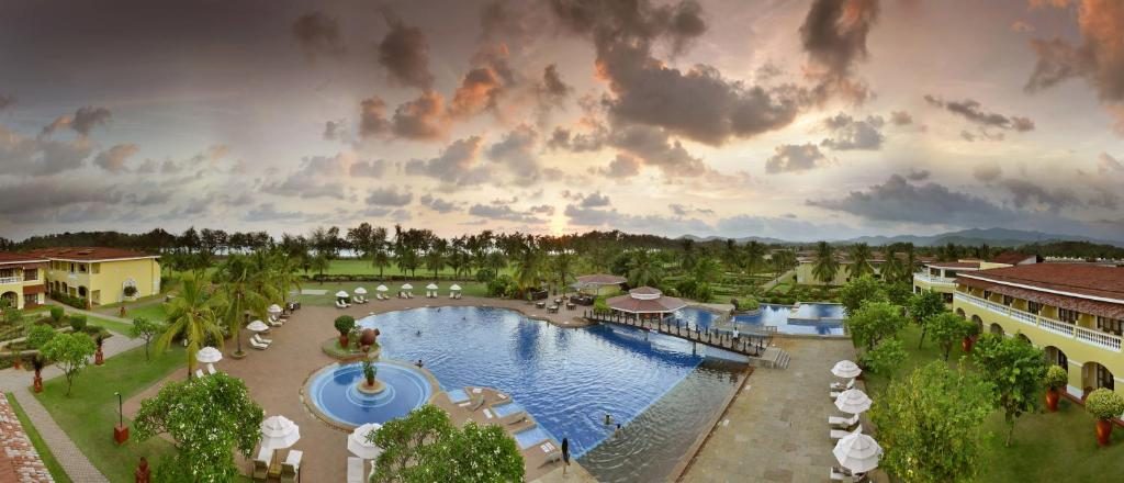 A view of the pool at The LaLiT Golf & Spa Resort Goa or nearby