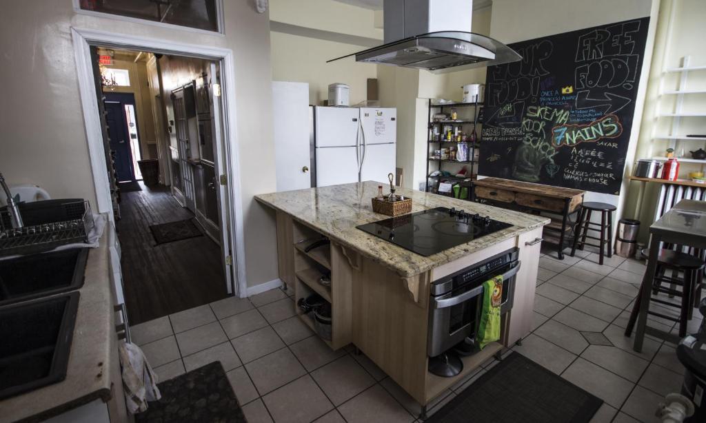 Cuisine ou kitchenette dans l'établissement DC Lofty
