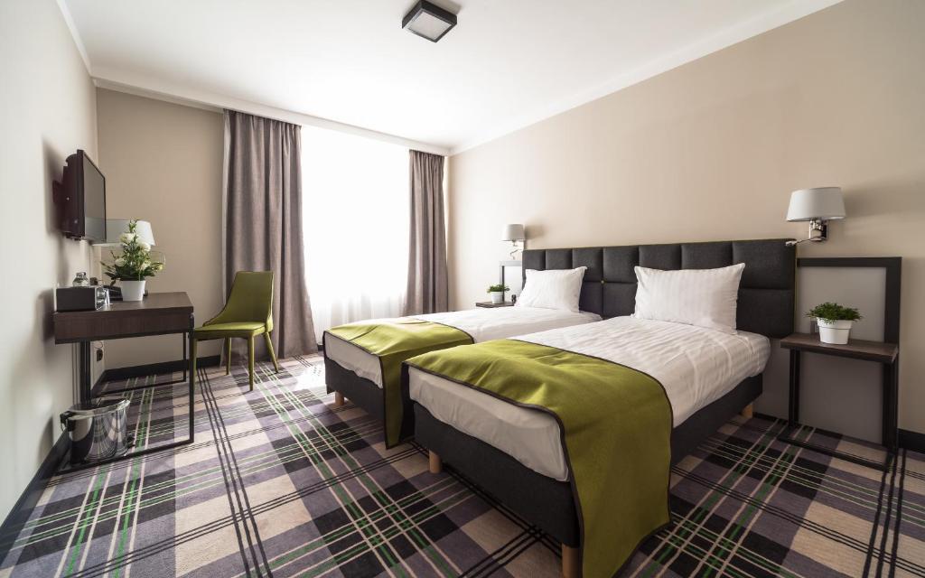 Łóżko lub łóżka w pokoju w obiekcie Hotel Impresja