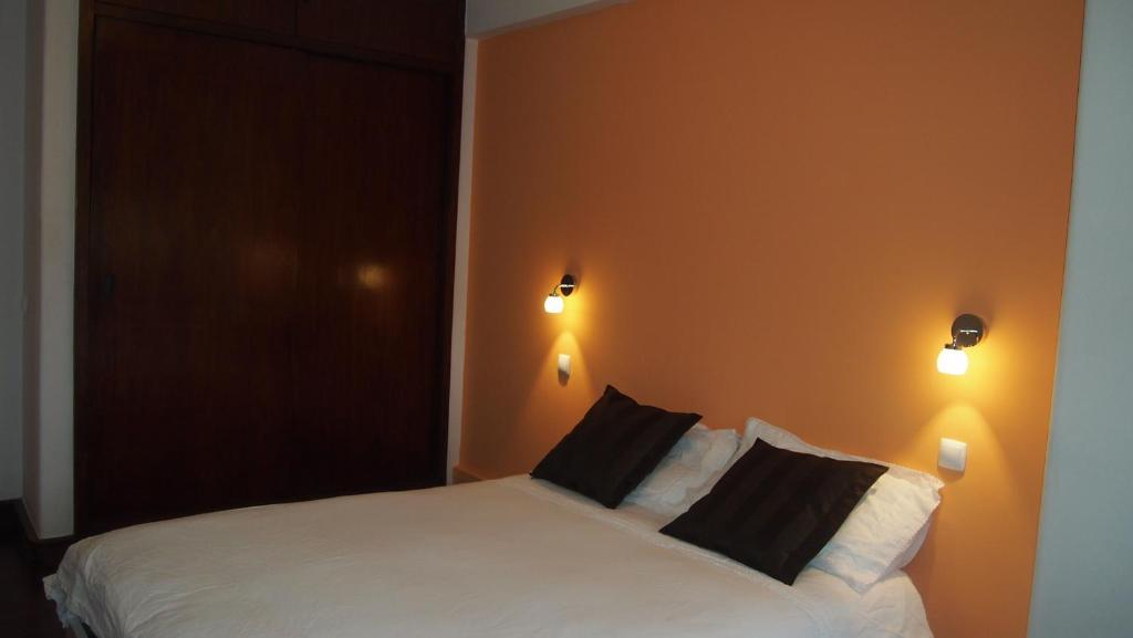 A bed or beds in a room at Lisbon Landscape Hostel