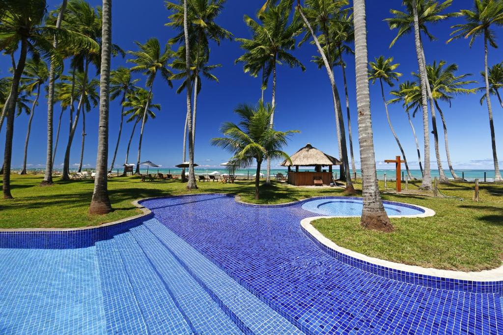 The swimming pool at or near Pontal dos Carneiros Beach Bungalows